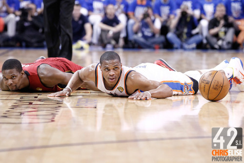 12 June 2012: Miami Heat power forward Chris Bosh (1) vies for the loose ball with Oklahoma City Thunder point guard Russell Westbrook (0) during the second half of Game 1 of the 2012 NBA Finals between the Heat and the Thunder, at the Chesapeake Energy Arena, Oklahoma City, Oklahoma, USA. © Chris Elise