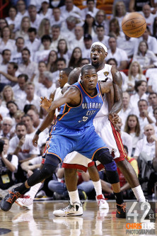 19 June 2012: Miami Heat small forward LeBron James (6) defends on Oklahoma City Thunder small forward Kevin Durant (35) who eyes the ball during the third quarter of Game 4 of the 2012 NBA Finals, Thunder at Heat, at the AmericanAirlinesArena, Miami, Florida, USA. © Chris Elise