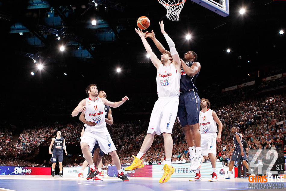 15 July 2012: Kevin Seraphin of Team France vies for the rebound with Pau Gasol of Team Spain during a pre-Olympic exhibition game won 75-70 by Spain over France, at the Palais Omnisports de Paris Bercy, in Paris, France. © Chris Elise