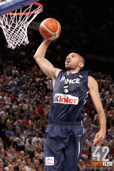 15 July 2012: Nicolas Batum of Team France dunks the ball during a pre-Olympic exhibition game won 75-70 by Spain over France, at the Palais Omnisports de Paris Bercy, in Paris, France. © Chris Elise